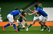 24 October 2020; Peter O'Mahony of Ireland offloads in the tackle by Federico Mori of Italy during the Guinness Six Nations Rugby Championship match between Ireland and Italy at the Aviva Stadium in Dublin. Photo by Ramsey Cardy/Sportsfile