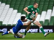 24 October 2020; Jacob Stockdale of Ireland is tackled by Abraham Steyn of Italy during the Guinness Six Nations Rugby Championship match between Ireland and Italy at the Aviva Stadium in Dublin. Photo by Ramsey Cardy/Sportsfile
