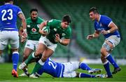 24 October 2020; Dave Heffernan of Ireland is tackled by Maxime Mbandà of Italy during the Guinness Six Nations Rugby Championship match between Ireland and Italy at the Aviva Stadium in Dublin. Due to current restrictions laid down by the Irish government to prevent the spread of coronavirus and to adhere to social distancing regulations, all sports events in Ireland are currently held behind closed doors. Photo by Brendan Moran/Sportsfile