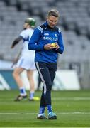 24 October 2020; Laois manager Eddie Brennan inspects a yellow sliotar before the Leinster GAA Hurling Senior Championship Quarter-Final match between Laois and Dublin at Croke Park in Dublin. Photo by Piaras Ó Mídheach/Sportsfile