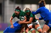 24 October 2020; Lindsay Peat, left, supported by Ciara Cooney of Ireland is tackled by Silvia Turani of Italy during the Women's Six Nations Rugby Championship match between Ireland and Italy at Energia Park in Dublin. Due to current restrictions laid down by the Irish government to prevent the spread of coronavirus and to adhere to social distancing regulations, all sports events in Ireland are currently held behind closed doors. Photo by Ramsey Cardy/Sportsfile