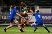 24 October 2020; Sene Naoupu of Ireland is tackled by Francesca Sgorbini and Veronica Madia of Italy during the Women's Six Nations Rugby Championship match between Ireland and Italy at Energia Park in Dublin. Due to current restrictions laid down by the Irish government to prevent the spread of coronavirus and to adhere to social distancing regulations, all sports events in Ireland are currently held behind closed doors. Photo by Brendan Moran/Sportsfile
