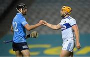 24 October 2020; Danny Sutcliffe of Dublin and Enda Rowland of Laois bump fists after the Leinster GAA Hurling Senior Championship Quarter-Final match between Laois and Dublin at Croke Park in Dublin. Photo by Piaras Ó Mídheach/Sportsfile