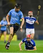 24 October 2020; Danny Sutcliffe of Dublin on the attack as Padraig Delaney of Laois looks on during the Leinster GAA Hurling Senior Championship Quarter-Final match between Laois and Dublin at Croke Park in Dublin. Photo by Piaras Ó Mídheach/Sportsfile