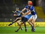 24 October 2020; Danny Sutcliffe of Dublin kicks the ball under pressure from Padraig Delaney and Jack Kelly, right, of Laois during the Leinster GAA Hurling Senior Championship Quarter-Final match between Laois and Dublin at Croke Park in Dublin. Photo by Piaras Ó Mídheach/Sportsfile