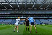 24 October 2020; Team captains Enda Rowland of Laois and Danny Sutcliffe of Dublin fist bump as referee Paud O'Dwyer looks on before the Leinster GAA Hurling Senior Championship Quarter-Final match between Laois and Dublin at Croke Park in Dublin. Photo by Piaras Ó Mídheach/Sportsfile