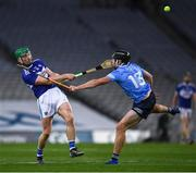 24 October 2020; Ross King of Laois in action against Donal Burke of Dublin during the Leinster GAA Hurling Senior Championship Quarter-Final match between Laois and Dublin at Croke Park in Dublin. Photo by Ray McManus/Sportsfile