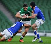 24 October 2020; Robbie Henshaw of Ireland is tackled by Paolo Garbisi and Bundee Aki of Ireland during the Guinness Six Nations Rugby Championship match between Ireland and Italy at the Aviva Stadium in Dublin. Due to current restrictions laid down by the Irish government to prevent the spread of coronavirus and to adhere to social distancing regulations, all sports events in Ireland are currently held behind closed doors. Photo by Brendan Moran/Sportsfile
