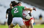 25 October 2020; Darragh Canavan of Tyrone is tackled by Oisín Mullin of Mayo during the Allianz Football League Division 1 Round 7 match between Mayo and Tyrone at Elverys MacHale Park in Castlebar, Mayo. Photo by Piaras Ó Mídheach/Sportsfile