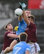 25 October 2020; Brian Fenton of Dublin in action against Tom Flynn, left, and Paul Conroy of Galway during the Allianz Football League Division 1 Round 7 match between Galway and Dublin at Pearse Stadium in Galway. Photo by Ramsey Cardy/Sportsfile