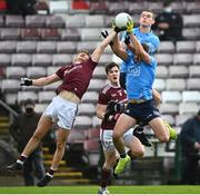 25 October 2020; Johnny Heaney of Galway in action against Brian Howard, below, and Brian Fenton of Dublin during the Allianz Football League Division 1 Round 7 match between Galway and Dublin at Pearse Stadium in Galway. Photo by Ramsey Cardy/Sportsfile