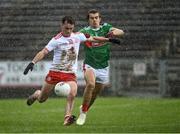 25 October 2020; Darragh Canavan of Tyrone shoots to score his side's second goal as Oisín Mullin of Mayo closes in during the Allianz Football League Division 1 Round 7 match between Mayo and Tyrone at Elverys MacHale Park in Castlebar, Mayo. Photo by Piaras Ó Mídheach/Sportsfile
