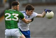 25 October 2020; Stephen O'Hanlon of Monaghan in action against Jordan Morris of Meath during the Allianz Football League Division 1 Round 7 match between Monaghan and Meath at St Tiernach's Park in Clones, Monaghan. Photo by Harry Murphy/Sportsfile