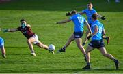 25 October 2020; Seán Bugler of Dublin shoots to score his side's first goal despite the attention of James Foley of Galway during the Allianz Football League Division 1 Round 7 match between Galway and Dublin at Pearse Stadium in Galway. Photo by Ramsey Cardy/Sportsfile