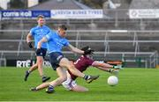 25 October 2020; Con O'Callaghan of Dublin shoots to score his side's second goal despite the attention of Sean Mulkerrin of Galway during the Allianz Football League Division 1 Round 7 match between Galway and Dublin at Pearse Stadium in Galway. Photo by Ramsey Cardy/Sportsfile