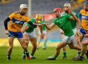 25 October 2020; Ryan Taylor of Clare in action against Barry Nash of Limerick during the Munster GAA Hurling Senior Championship Quarter-Final match between Limerick and Clare at Semple Stadium in Thurles, Tipperary. This game also doubles up as the Allianz Hurling League Division 1 Final as the GAA season was shortened due to the coronavirus pandemic and both teams had qualified for the final. Photo by Ray McManus/Sportsfile