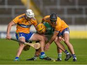 25 October 2020; Tom Morrissey of Limerick in action against Patrick O'Connor, left, and Stephen O'Halloran of Clare during the Munster GAA Hurling Senior Championship Quarter-Final match between Limerick and Clare at Semple Stadium in Thurles, Tipperary. This game also doubles up as the Allianz Hurling League Division 1 Final as the GAA season was shortened due to the coronavirus pandemic and both teams had qualified for the final. Photo by Daire Brennan/Sportsfile