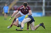 25 October 2020; Con O'Callaghan of Dublin is tackled by Cillian McDaid of Galway during the Allianz Football League Division 1 Round 7 match between Galway and Dublin at Pearse Stadium in Galway. Photo by Ramsey Cardy/Sportsfile