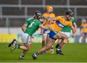 25 October 2020; Stephen O'Halloran of Clare in action against Graeme Mulcahy of Limerick during the Munster GAA Hurling Senior Championship Quarter-Final match between Limerick and Clare at Semple Stadium in Thurles, Tipperary. This game also doubles up as the Allianz Hurling League Division 1 Final as the GAA season was shortened due to the coronavirus pandemic and both teams had qualified for the final. Photo by Daire Brennan/Sportsfile