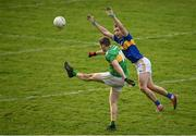25 October 2020; Keith Beirne of Leitrim kicks a point under pressure from Alan Campbell of Tipperary during the Allianz Football League Division 3 Round 7 match between Leitrim and Tipperary at Avantcard Páirc Sean Mac Diarmada in Carrick-on-Shannon, Leitrim. Photo by Seb Daly/Sportsfile