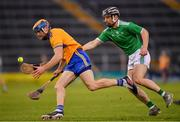 25 October 2020; Seadna Morey of Clare in action against Graeme Mulcahy of Limerick during the Munster GAA Hurling Senior Championship Quarter-Final match between Limerick and Clare at Semple Stadium in Thurles, Tipperary. This game also doubles up as the Allianz Hurling League Division 1 Final as the GAA season was shortened due to the coronavirus pandemic and both teams had qualified for the final. Photo by Ray McManus/Sportsfile