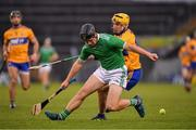 25 October 2020; Peter Casey of Limerick in action against Rory Hayes of Clare during the Munster GAA Hurling Senior Championship Quarter-Final match between Limerick and Clare at Semple Stadium in Thurles, Tipperary. This game also doubles up as the Allianz Hurling League Division 1 Final as the GAA season was shortened due to the coronavirus pandemic and both teams had qualified for the final. Photo by Ray McManus/Sportsfile