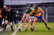 25 October 2020; Gearóid Hegarty of Limerick in action against Cathal Malone of Clare during the Munster GAA Hurling Senior Championship Quarter-Final match between Limerick and Clare at Semple Stadium in Thurles, Tipperary. This game also doubles up as the Allianz Hurling League Division 1 Final as the GAA season was shortened due to the coronavirus pandemic and both teams had qualified for the final. Photo by Ray McManus/Sportsfile
