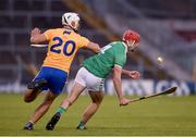 25 October 2020; Barry Nash of Limerick in action against Aron Shanagher of Clare during the Munster GAA Hurling Senior Championship Quarter-Final match between Limerick and Clare at Semple Stadium in Thurles, Tipperary. This game also doubles up as the Allianz Hurling League Division 1 Final as the GAA season was shortened due to the coronavirus pandemic and both teams had qualified for the final. Photo by Daire Brennan/Sportsfile
