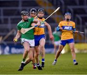 25 October 2020; Diarmaid Byrnes of Limerick in action against Tony Kelly of Clare during the Munster GAA Hurling Senior Championship Quarter-Final match between Limerick and Clare at Semple Stadium in Thurles, Tipperary. This game also doubles up as the Allianz Hurling League Division 1 Final as the GAA season was shortened due to the coronavirus pandemic and both teams had qualified for the final. Photo by Ray McManus/Sportsfile