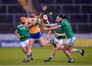 25 October 2020; David McInerney of Clare in action against Cian Lynch, left, and Declan Hannon of Limerick during the Munster GAA Hurling Senior Championship Quarter-Final match between Limerick and Clare at Semple Stadium in Thurles, Tipperary. This game also doubles up as the Allianz Hurling League Division 1 Final as the GAA season was shortened due to the coronavirus pandemic and both teams had qualified for the final. Photo by Daire Brennan/Sportsfile