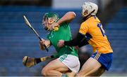 25 October 2020; Seán Finn of Limerick in action against Ryan Taylor of Clare during the Munster GAA Hurling Senior Championship Quarter-Final match between Limerick and Clare at Semple Stadium in Thurles, Tipperary. This game also doubles up as the Allianz Hurling League Division 1 Final as the GAA season was shortened due to the coronavirus pandemic and both teams had qualified for the final. Photo by Daire Brennan/Sportsfile