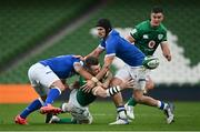 24 October 2020; Peter O'Mahony of Ireland offloads in the tackle by Federico Mori, left, and Carlo Canna of Italy during the Guinness Six Nations Rugby Championship match between Ireland and Italy at the Aviva Stadium in Dublin. Photo by Ramsey Cardy/Sportsfile