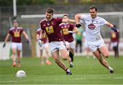 24 October 2020; John Heslin of Westmeath and Con Kavanagh of Kildare chase the loose ball during the Allianz Football League Division 2 Round 7 match between Kildare and Westmeath at St Conleth's Park in Newbridge, Kildare. Photo by Piaras Ó Mídheach/Sportsfile