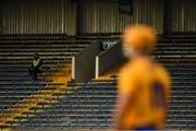 25 October 2020; A 'Maor' watches the game from an empty stand during the Munster GAA Hurling Senior Championship Quarter-Final match between Limerick and Clare at Semple Stadium in Thurles, Tipperary. This game also doubles up as the Allianz Hurling League Division 1 Final as the GAA season was shortened due to the coronavirus pandemic and both teams had qualified for the final. Photo by Ray McManus/Sportsfile