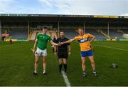 25 October 2020; The Limerick, Declan Hannon, and Clare captains, David McInerney, greet each other across referee Fergal Horgan before the Munster GAA Hurling Senior Championship Quarter-Final match between Limerick and Clare at Semple Stadium in Thurles, Tipperary. This game also doubles up as the Allianz Hurling League Division 1 Final as the GAA season was shortened due to the coronavirus pandemic and both teams had qualified for the final. Photo by Ray McManus/Sportsfile