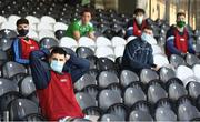 24 October 2020; Limerick subsitutes watch the match socially distanced during the Allianz Football League Division 4 Round 7 match between Sligo and Limerick at Markievicz Park in Sligo. Photo by Harry Murphy/Sportsfile