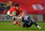 26 October 2020; Calvin Nash of Munster is tackled by Matthew Morgan of Cardiff Blues during the Guinness PRO14 match between Munster and Cardiff Blues at Thomond Park in Limerick. Photo by Ramsey Cardy/Sportsfile