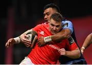 26 October 2020; Rory Scannell of Munster is tackled by Willis Halaholo of Cardiff Blues during the Guinness PRO14 match between Munster and Cardiff Blues at Thomond Park in Limerick. Photo by Ramsey Cardy/Sportsfile