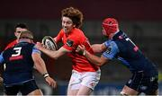 26 October 2020; Ben Healy of Munster is tackled by James Botham, right, and Dimitri Arhip of Cardiff Blues during the Guinness PRO14 match between Munster and Cardiff Blues at Thomond Park in Limerick. Photo by Harry Murphy/Sportsfile