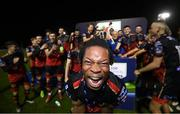 27 October 2020; Jordan Adetemo of Drogheda United celebrates with his team-mates following the SSE Airtricity First Division trophy following their match against Cabinteely at Stradbrook in Blackrock, Dublin. Photo by Stephen McCarthy/Sportsfile
