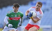 25 October 2020; Peter Harte of Tyrone in action against Tommy Conroy of Mayo during the Allianz Football League Division 1 Round 7 match between Mayo and Tyrone at Elverys MacHale Park in Castlebar, Mayo. Photo by Piaras Ó Mídheach/Sportsfile