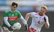 25 October 2020; Tommy Conroy of Mayo in action against Hugh Pat McGeary of Tyrone during the Allianz Football League Division 1 Round 7 match between Mayo and Tyrone at Elverys MacHale Park in Castlebar, Mayo. Photo by Piaras Ó Mídheach/Sportsfile
