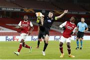 29 October 2020; Brian Gartland of Dundalk in action against Eddie Nketiah, right, and Ainsley Maitland-Niles of Arsenal during the UEFA Europa League Group B match between Arsenal and Dundalk at the Emirates Stadium in London, England. Photo by Matt Impey/Sportsfile