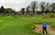 31 October 2020; Glen Spence from Belfast, Northern Ireland plays from a bunker on Down Royal golf course as the field passes by during the Tayto Group Maiden hurdle at Down Royal Racecourse in Lisburn, Down. Photo by David Fitzgerald/Sportsfile