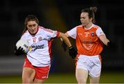 30 October 2020; Chloe McCaffrey of Tyrone in action against Sarah Marley of Armagh during the TG4 All-Ireland Senior Ladies Football Championship Round 1 match between Tyrone and Armagh at Kingspan Breffni Park in Cavan. Photo by Stephen McCarthy/Sportsfile