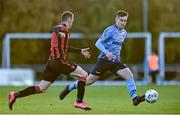31 October 2020; Evan Weir of UCD in action against Shane Elworthy of Longford Town during the SSE Airtricity League First Division Play-off Semi-Final match between UCD and Longford Town at the UCD Bowl in Belfield, Dublin. Photo by Sam Barnes/Sportsfile