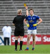 31 October 2020; Cormac O'Reilly of Cavan receives a yellow card from referee Ciaran Branagan during the Ulster GAA Football Senior Championship Preliminary Round match between Monaghan and Cavan at St Tiernach's Park in Clones, Monaghan. Photo by Stephen McCarthy/Sportsfile