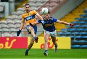 1 November 2020; Gary Brennan of Clare in action against Conal Kennedy of Tipperary during the Munster GAA Football Senior Championship Quarter-Final match between Tipperary and Clare at Semple Stadium in Thurles, Tipperary. Photo by Diarmuid Greene/Sportsfile