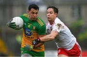 1 November 2020; Paul Brennan of Donegal in action against Kieran McGeary of Tyrone  during the Ulster GAA Football Senior Championship Quarter-Final match between Donegal and Tyrone at Pairc MacCumhaill in Ballybofey, Donegal. Photo by Harry Murphy/Sportsfile
