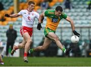 1 November 2020; Caolan McGonigle of Donegal in action against Peter Harte of Tyrone during the Ulster GAA Football Senior Championship Quarter-Final match between Donegal and Tyrone at Pairc MacCumhaill in Ballybofey, Donegal. Photo by Harry Murphy/Sportsfile